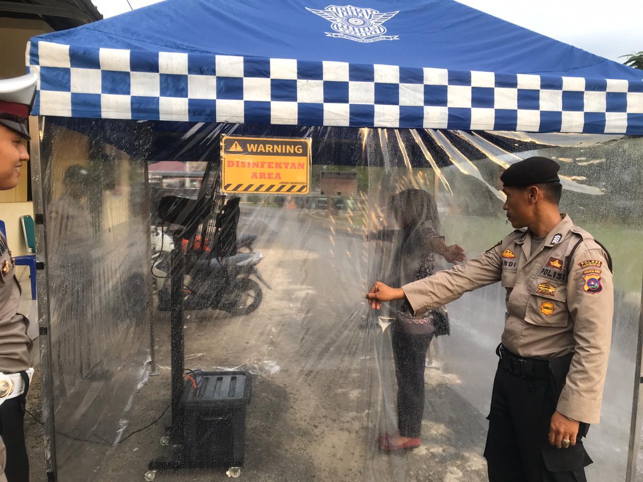 Polres Dharmasraya Dirikan Tenda Sterilisasi Antisipasi Penyebaran Covid 19