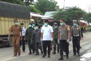 Pemkab dan Polres Dharmasraya Bersinergi Cegah Covid 19 di Gerbang Perbatasan