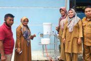 Ketua Posyantek Tanah Datar Serahkan Alat Cuci Tangan Anti Virus Kepada PMD