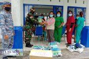 Penyerahan Bantuan APD Untuk Puskesmas Malakopak di Dampingi Babinsa Sikakap