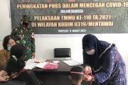 Pemberian Imunisasi dan Timbang Balita di Poliknik Pratama Poskes di Bantu Bakes Satgas TMMD