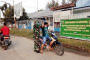Karya Bhakti TNI, Koramil 04/Sikakap Lakukan Penertiban dan Pembagian Masker