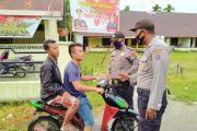 Polsek Sipora Beri Tindakan Disiplin Bagi Penggendara Tidak Pakai Masker di Jalan Sioban